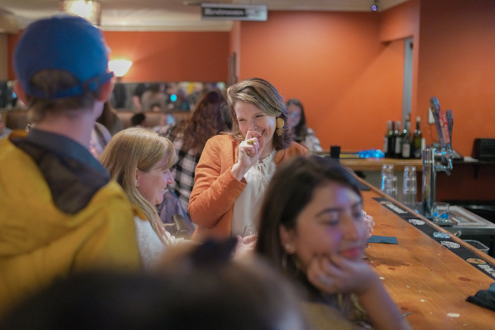 "Columbia resident Leah Christian makes a joke while waiting to order a drink on Tuesday, Nov. 6, 2018 in The Tiger Hotel. ""I'm extremely happy to support candidates who will bring a brighter future for Missouri,"" she said."
