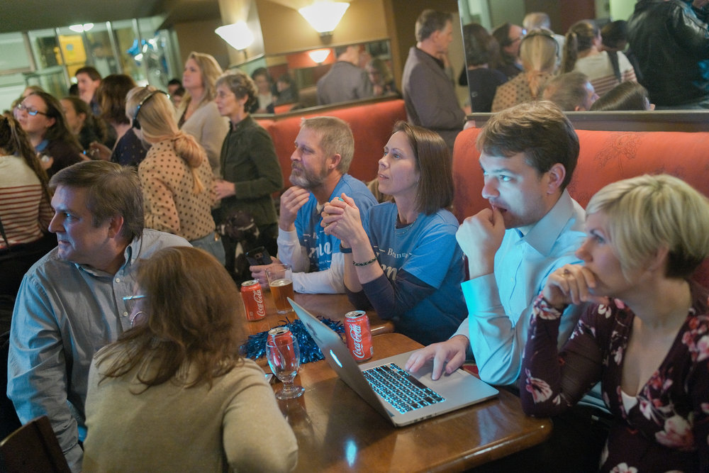 Attendees of the Boone County Democrats watch party, including Brianna Lennon, candidate for Boone County Clerk, watch the TV for results on amendment 2, a legalization of medical marijuana on Tuesday, Nov. 6, 2018 in The Tiger Hotel. The amendment was passed.