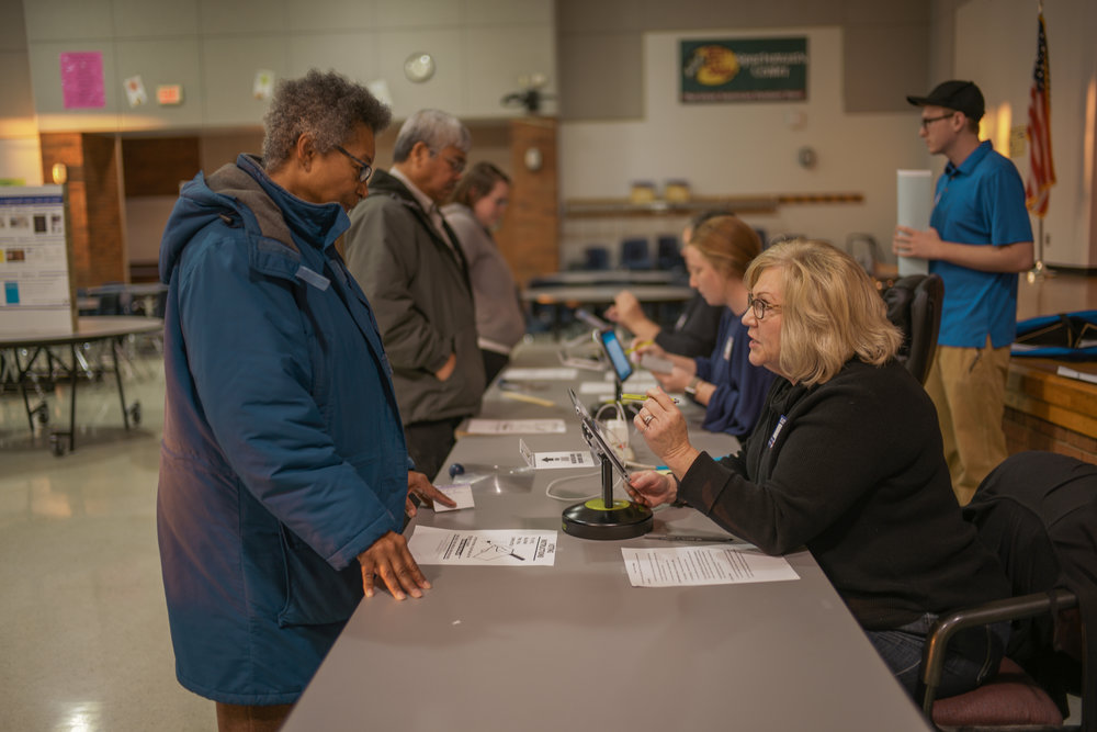 Volunteer Deb Taylor verifies Shirley Freelob's address on Tuesday, Nov. 6, 2018 at John B. Lang Middle School in Columbia. Freelob has lived in Columbia her entire life.