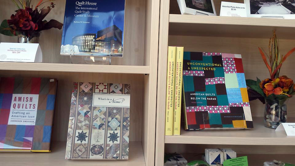 Amazing company for U&U. Note Janneken Smucker's excellent book, Amish Quilts: Creating an American Icon -- I highly recommend it. Gift shop at the International Quilt Study Center & Museum in Lincoln, Nebraska. Image courtesy of Leslie Levy, Executive Director at the IQSCM.