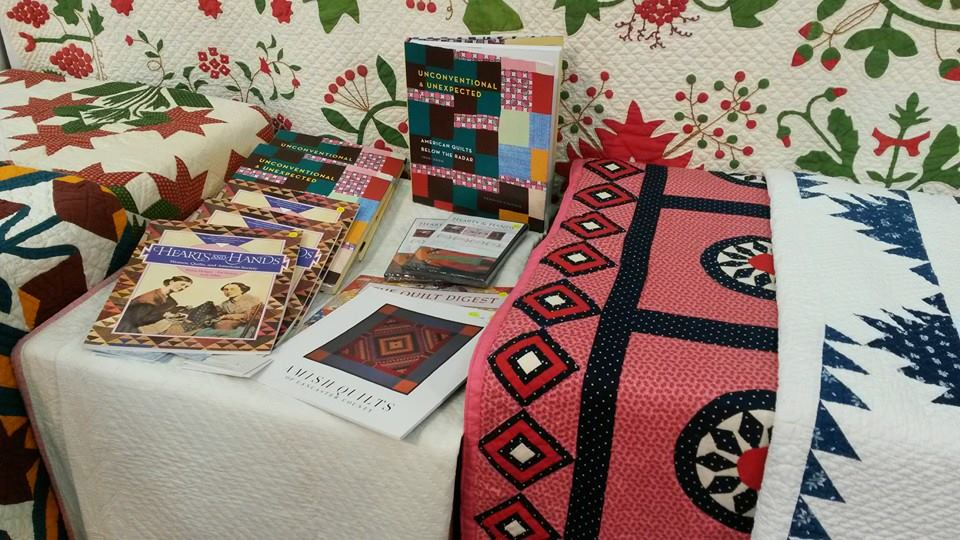 Autographed copies of U&U at the booth for Julie Silber's The Quilt Complex, #937 at the George R. Brown Convention Center. Thanks to Deborah Turner Ursell for the image!