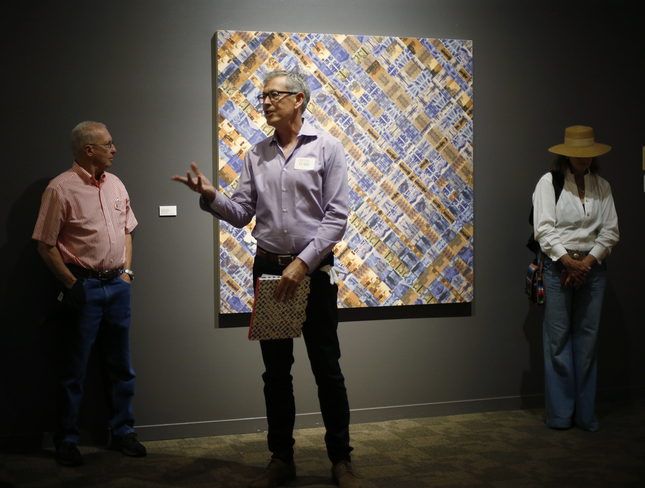 "Guest Curater Roderick Kiracofe talks to exhibit guests during the opening reception at the ""Found/Made"" exhibition at the San Jose Museum of Quilts & Textiles during the first SoFA Sundays, in San Jose, Calif., on Sunday, July 26, 2015. (Josie Lepe/Bay Area News Group)"