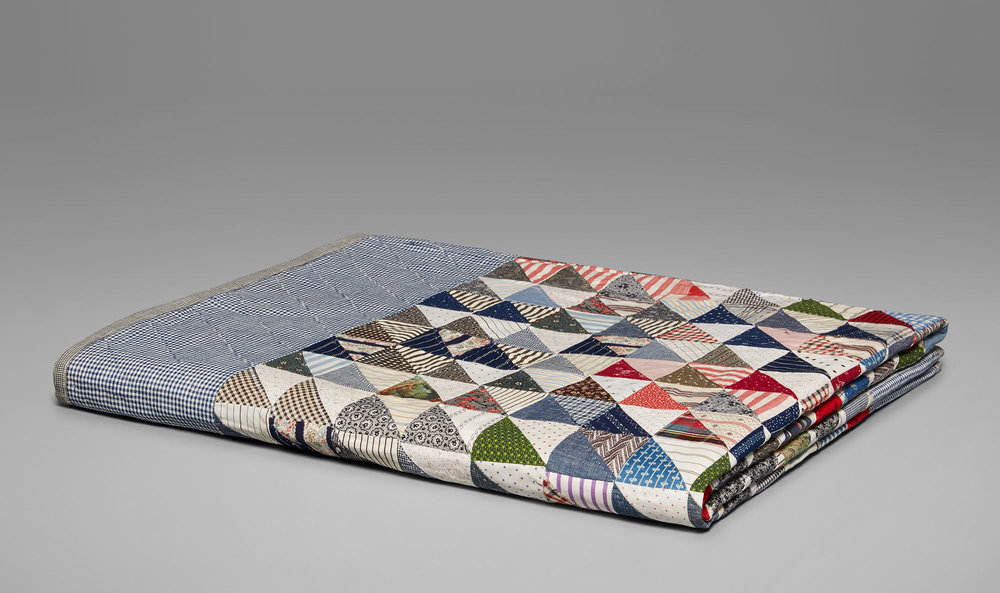 A vintage embroidered quilt, available at the Calvin Klein store on Madison Avenue.