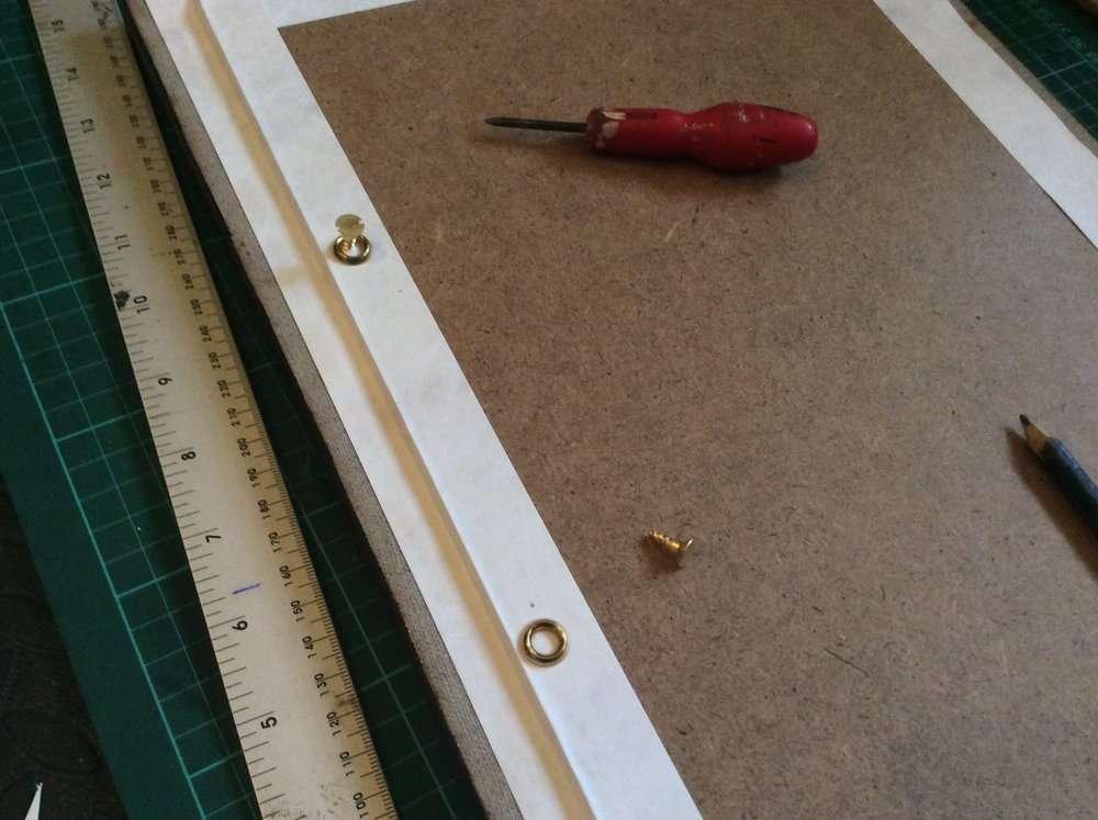 I used a centre pin punch to make a pilot hole for the screws.
