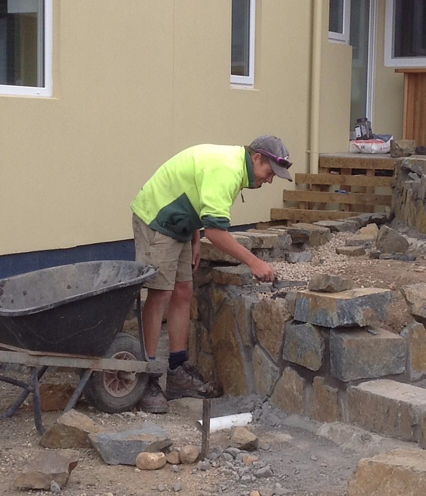 Andrew at work building a fantastic stone wall!