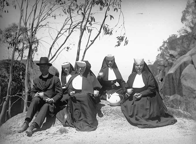 These nuns would have been very cross to climb all the way up this mountain only to discover their teapot was inferior. (Enamel teapot excused due to fragility of porcelain in rocky environments). One would hope even the most unprincipled teapot-seller would refrain from selling shoddy wares to members of the clergy. [Clergyman and five nuns sitting on rock drinking tea, teapot between them, Mt. Buffalo, Vic.], glass plate negative, ca 1890-19300. Alice Manfield, photographer. State Library of Victoria, H2003.96/28.