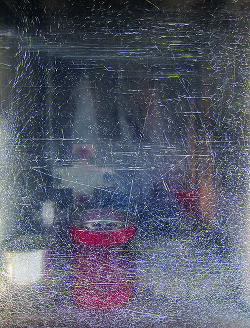 Cemetery votive box, seen through scratched Perspex door. Photograph by Savina Hopkins, 2014. Savina Hopkins is an artist from Melbourne. See more of her artwork at  savinahopkins.blogspot.com.au.
