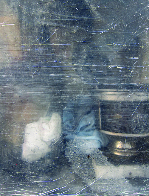 Cemetery votive box, seen through scratched Perspex door. Photograph by Savina Hopkins, 2014. Savina Hopkins is an artist from Melbourne. See more of her artwork at  savinahopkins.blogspot.com.au .