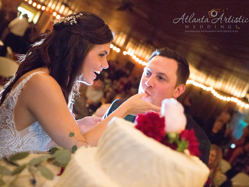 A candid moment between a bride and groom on their wedding day by the Atlanta wedding photographers at www.AtlantaArtisticWeddings.com.