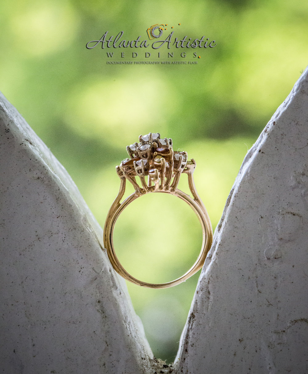 Atlanta Wedding Photographers use Gingerbread Detail of Historic Venue to Display Wedding Rings