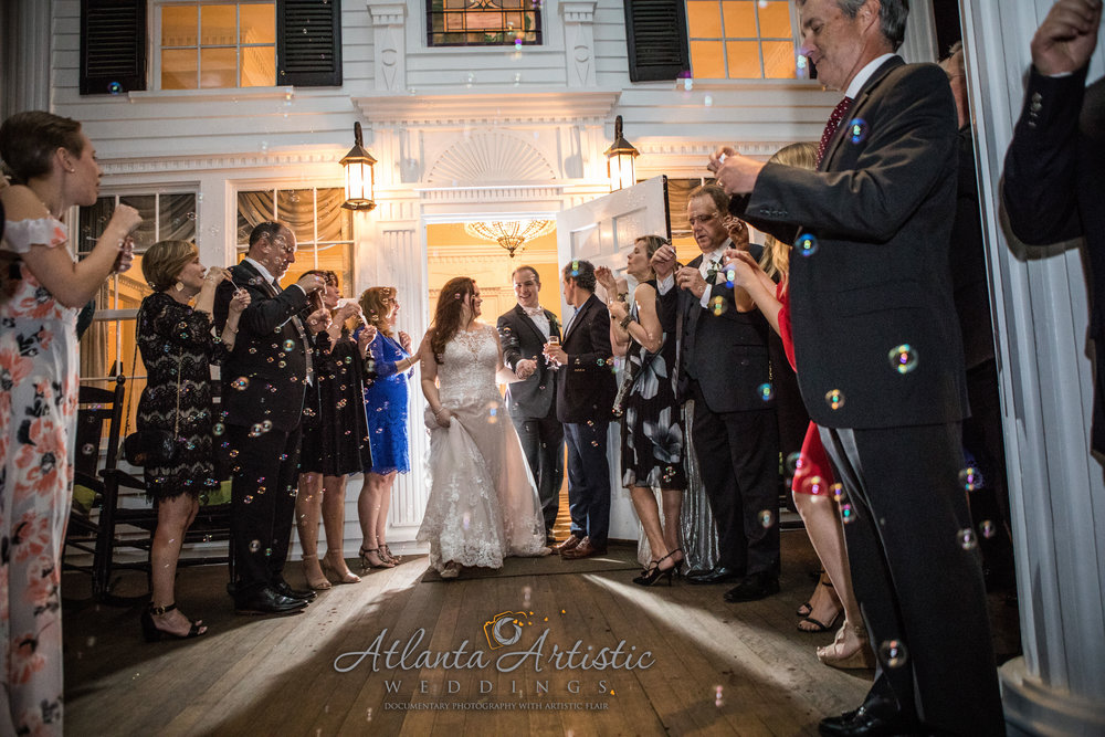 Wedding Exit with Bubbles at Naylor Hall by Atlanta wedding photographers at AtlantaArtisticWeddings
