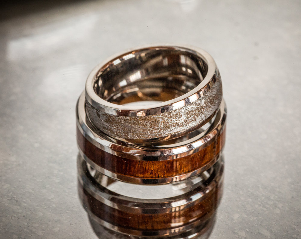 Wedding Rings with white gold and wood inlays photo by the Atlanta wedding photographers at Atlanta Artistic Weddings