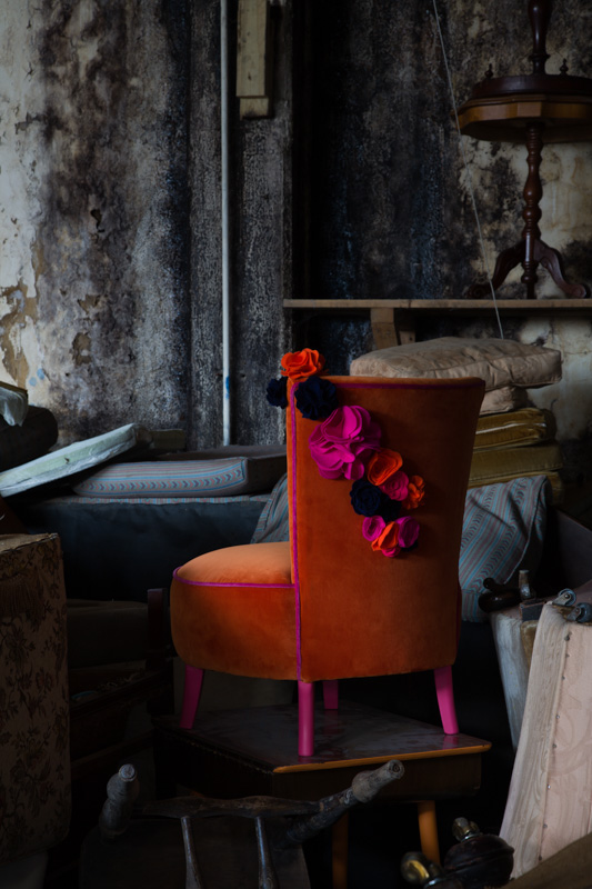 Betty Boo - Boudoir chair upholstered with love by  Out of the Dark  for our collaboration The Flower Project.  Lush orange velvet with pink piping and pink legs, and finished with handmade felt flowers in orange, pink and navy blue. One of a kind. £695.00  Photo credit:  Paul Craig