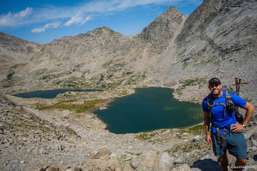 Dave hiking up Texas Pass with Texas Lake and Barren Lake in the background.