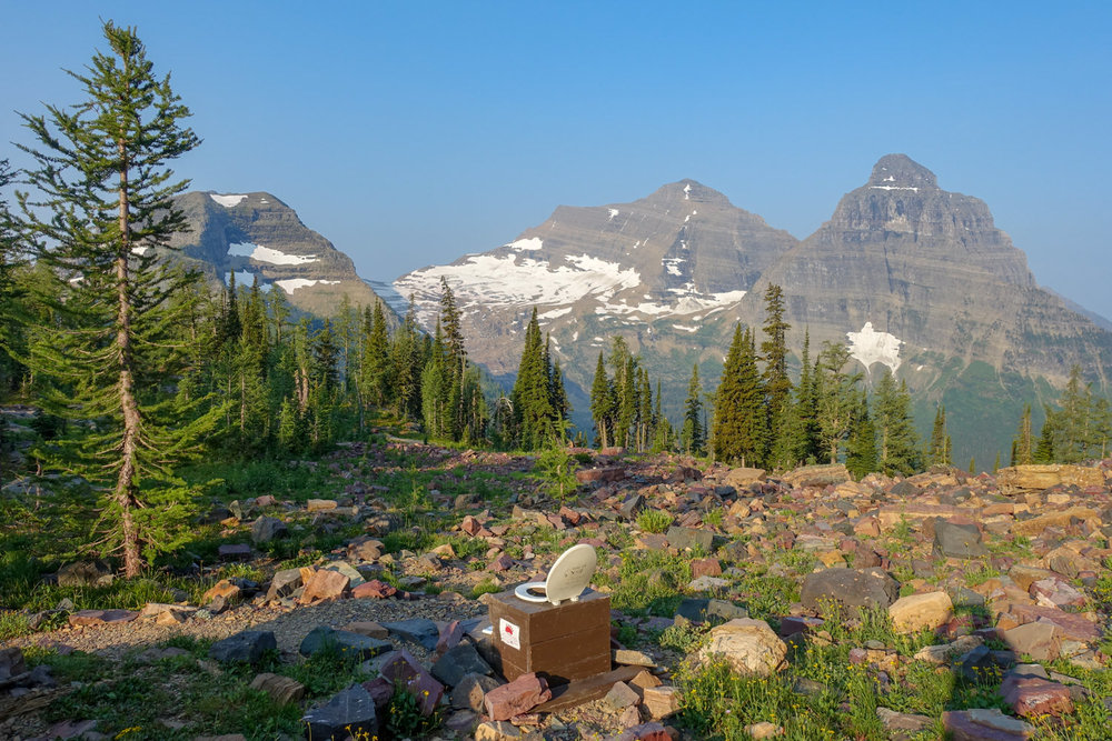 A scenic pit toilet in glacier national park