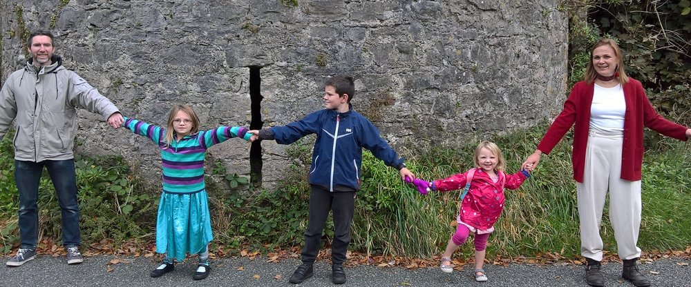 The Vines family linking their hands in front of the gun tower on the southern walls.