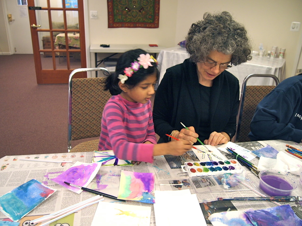 We try our best to give individual attention.  Our professional artist working hand in hand with one of our students.