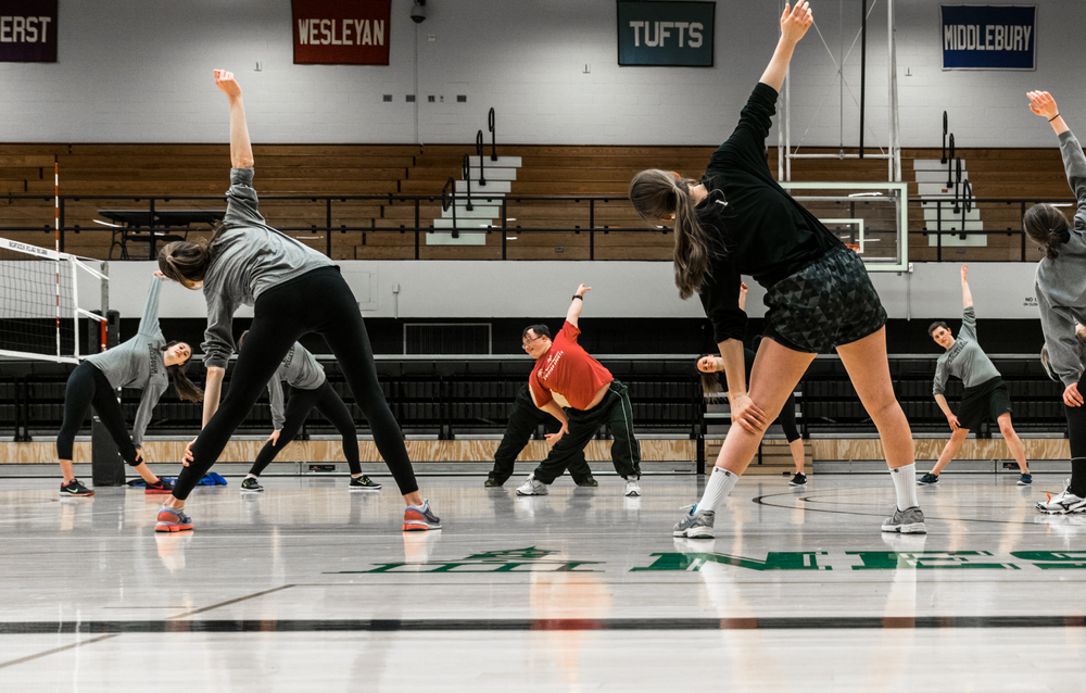 Bowdoin Girls' Volleyball hosted a practice with the people from Special Olympics. A man from Special Olympics led the stretches.