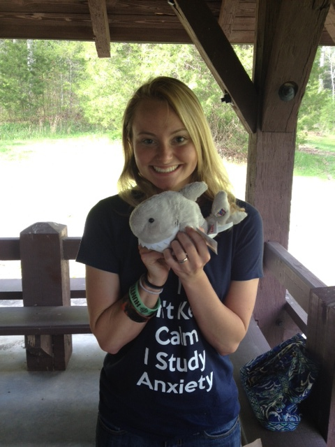 Devon Ruhde and her new stuffed friend