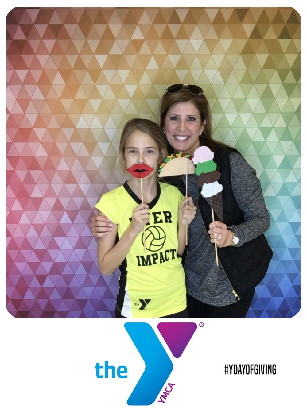 YMCA members using our handmade props with the GIF Booth.