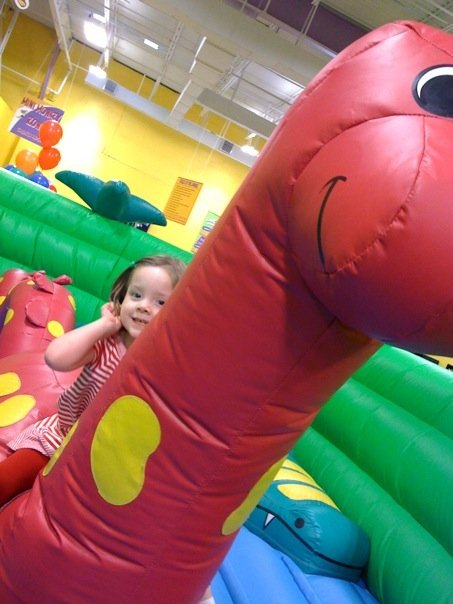 Riding the dino in the toddler area at Monkey Joes