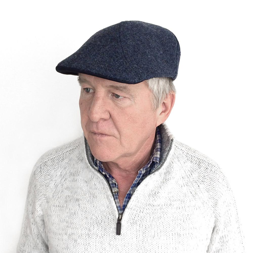 Eric wears 'Clive' flat cap in dark blue Shetland wool   buy online