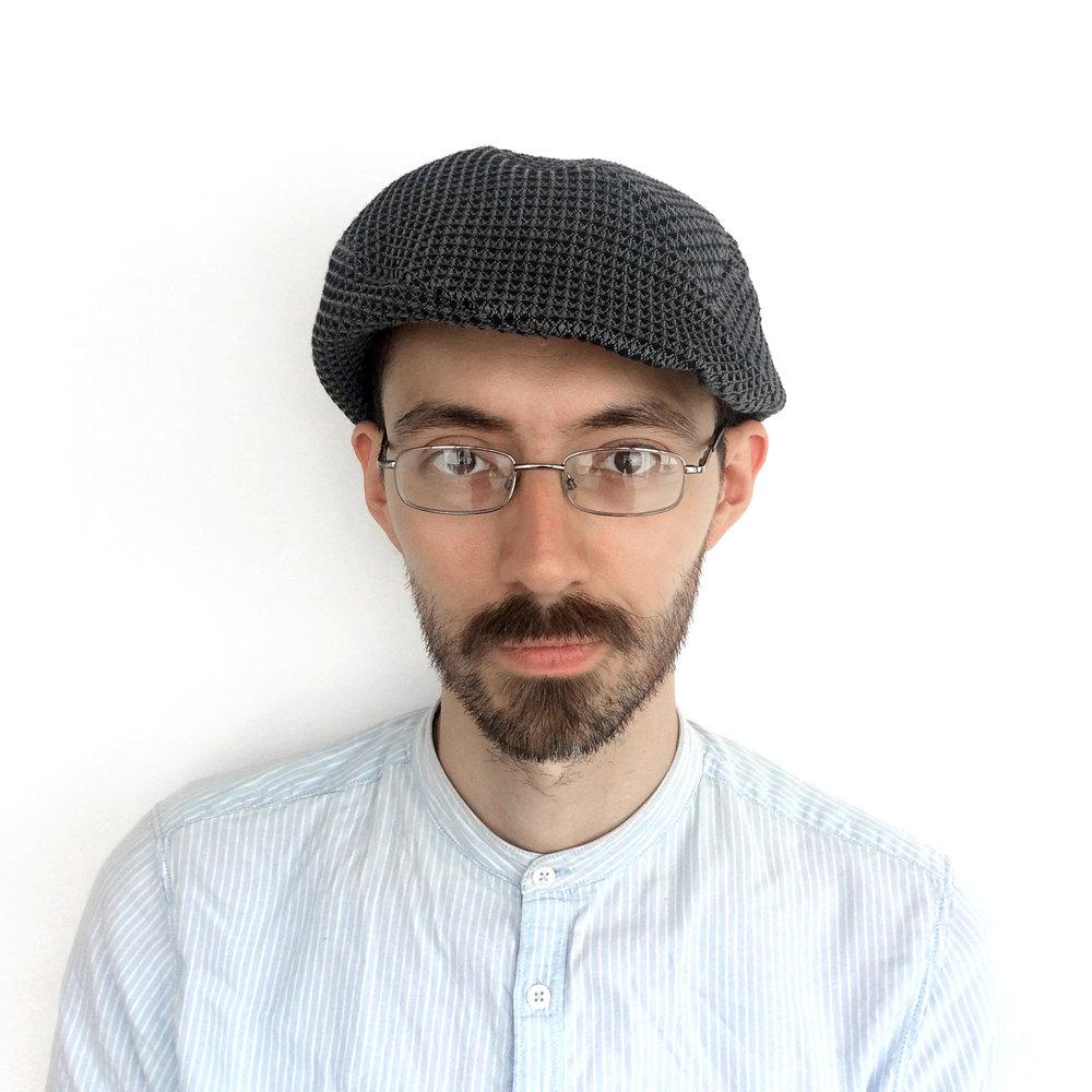 Theo wears 'Assa' beret-cap in organic cotton   buy online