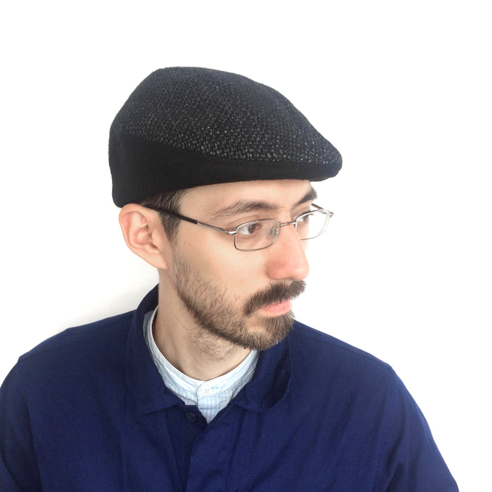 Theo wears 'Gower' beret-cap in black Linton tweed   buy online