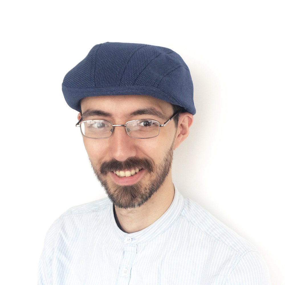 Theo wears 'Gower' beret-cap in French navy cotton-blend   buy online