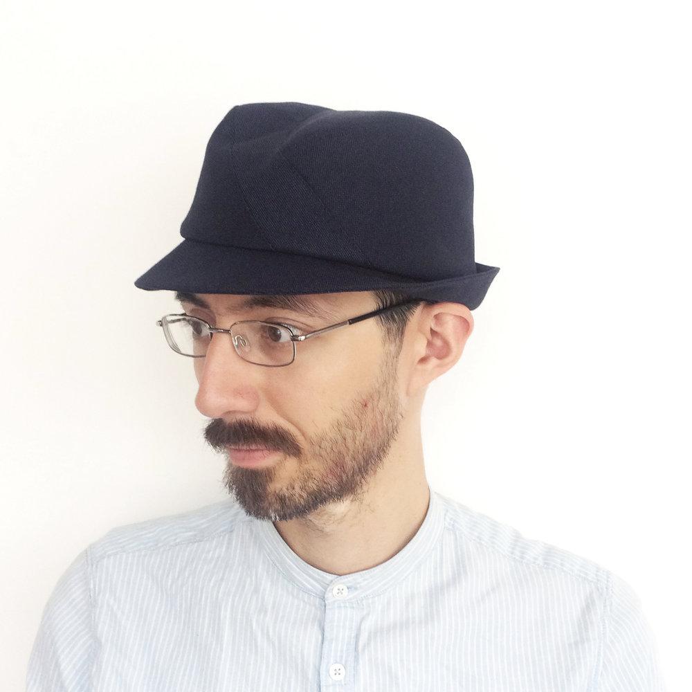 Theo wears 'Berwick' trilby hat in navy Irish linen   buy online
