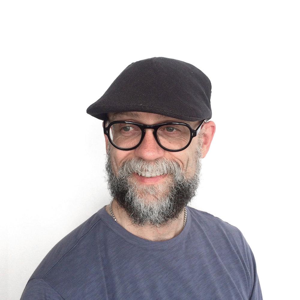 James wears 'Clive' flat cap in dark brown Irish linen   buy online