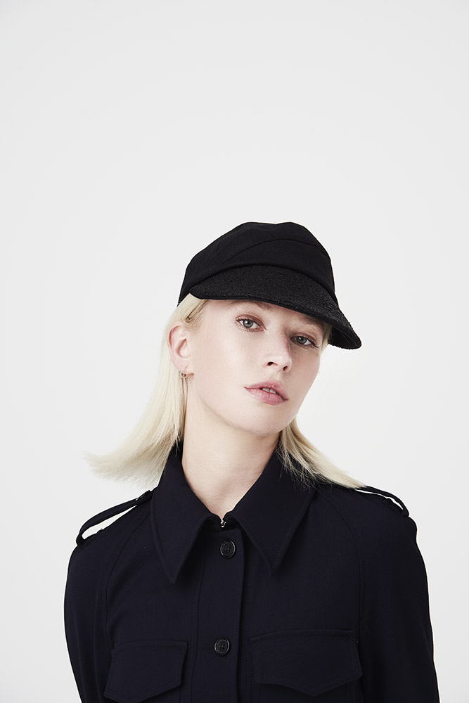 'Petra' peaked cap in black linen with vintage raffia