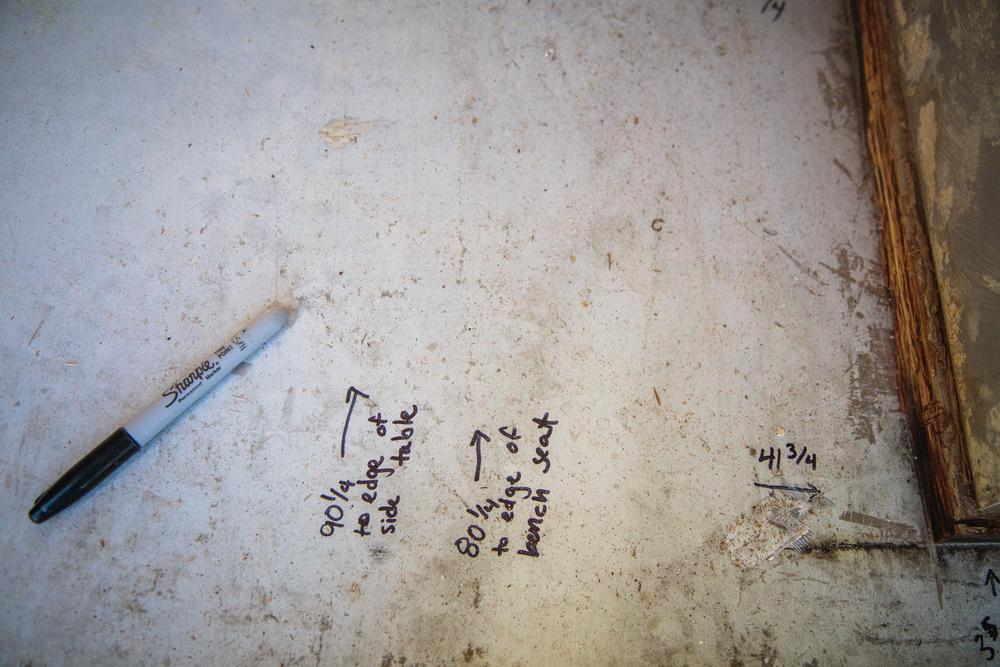 Measurements written on floor.