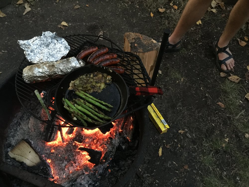 Dre and Caleb organized a superb campfire potluck, with dishes coming out all night, all cooked over coals. Brats, lamb, asparagus, root vegetables, shallots, and more.