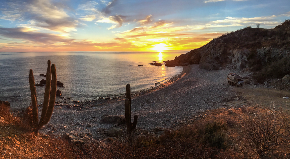 The rocky cove at sunrise that earned Mauricio the cover of the Rovers North calendar.
