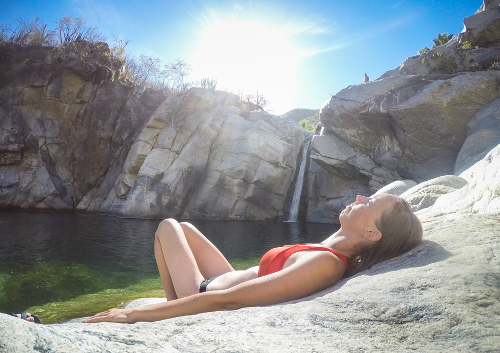 Sun bathing on the warm rocks was as appealing as swimming.