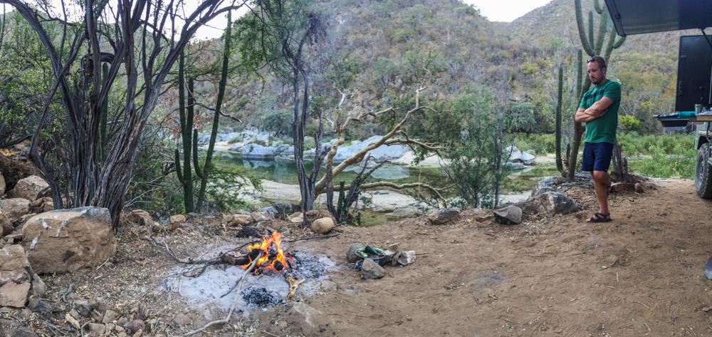 Preparing a campfire to cook steak and veggies.