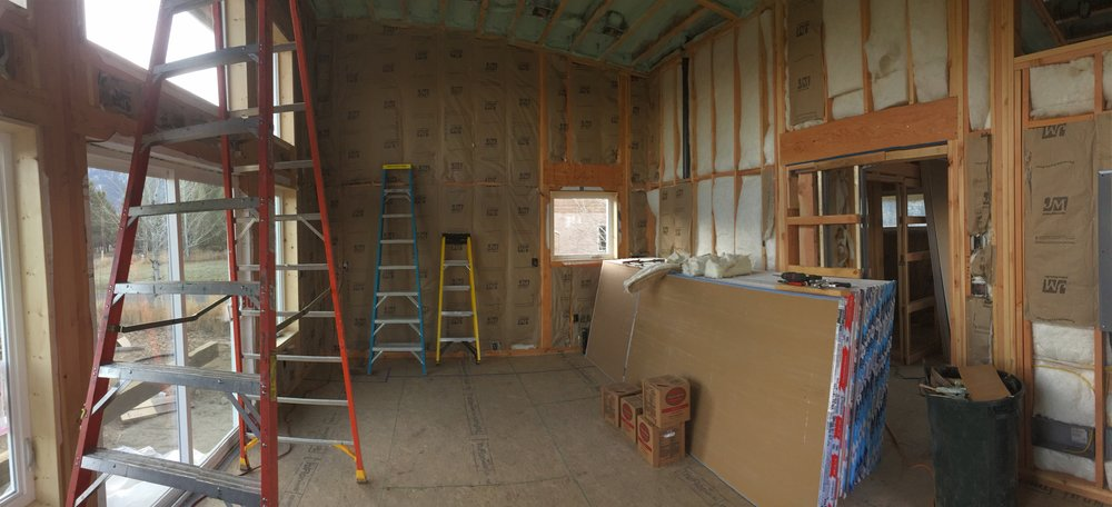 The interior, with insulation shortly before we had a team come put in drywall (we were going to do it ourselves, but were warned against how labor intensive it would be and how much time it would take with just the two of us. We're so happy we hired someone else to do it for us.