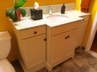 This custom vanity allows for storage without overwhelming the narrow room.