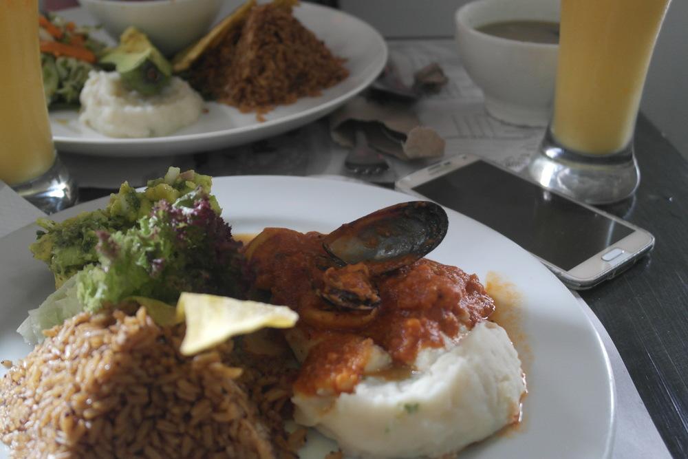 Fish, coconut rice, avocados, potatoes, yuca chip, and drink at La Mulata