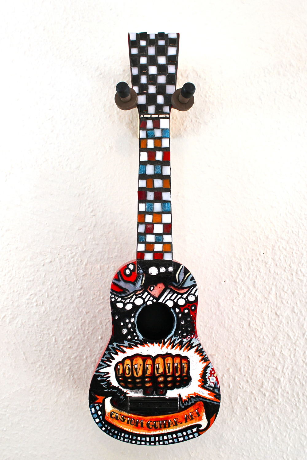 Knuckle Tattoo and Mosaic Ukulele