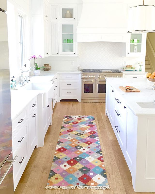 Well, now this is a cheerful rug! This family is so fun and carefree...she picked a rug that fits them perfectly, and highlights their eclectic, quirky art collection💗💙💚💛