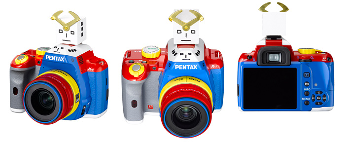 photojojo :     The   newest Pentax limited edition DSL  R   includes a delightfully rainbow camera body and a robot head that fits on the hot shoe.    Are you thinking what we're thinking? TRANSFORMER CAMERA!! (In Japan, this robot-y goodness is known as  Korejanai .)