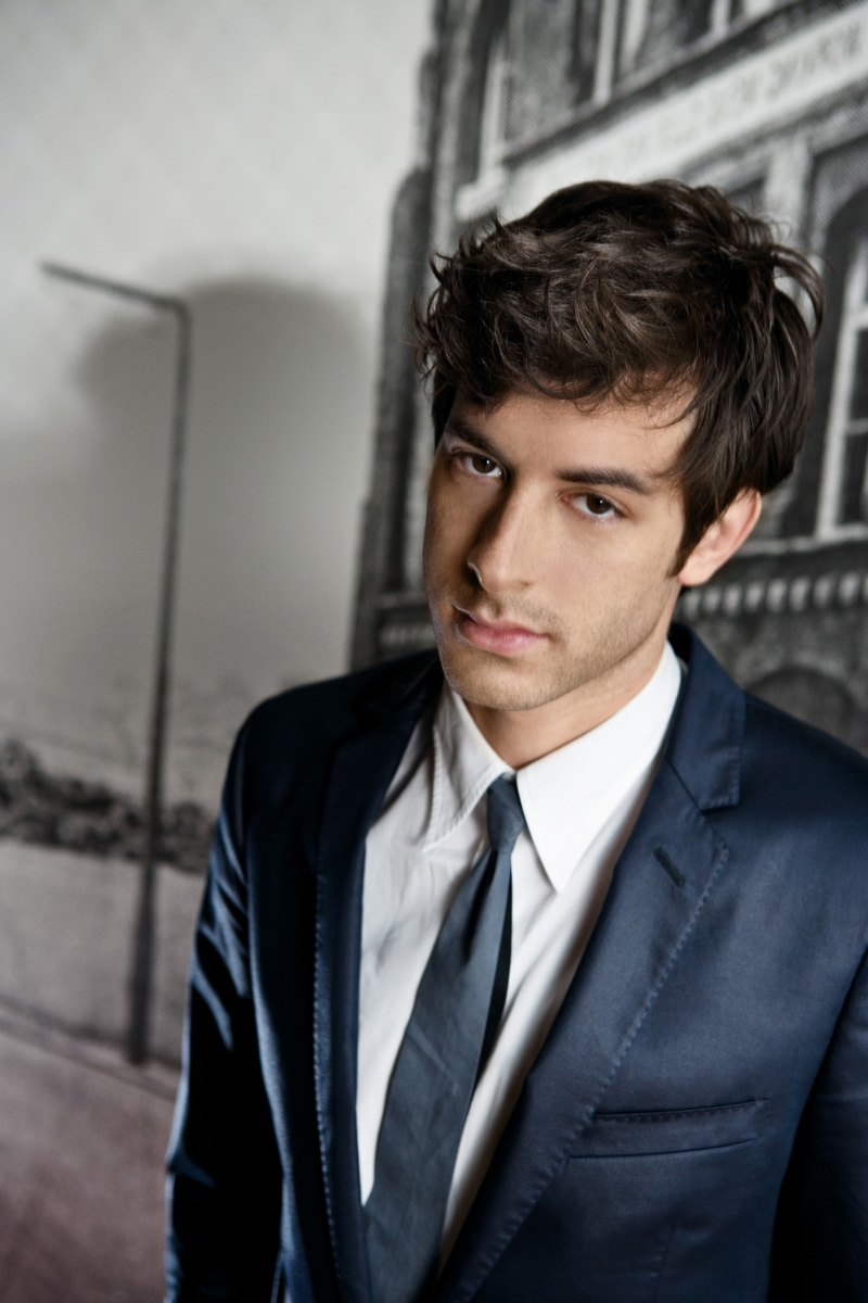 whytheyrehot :      Why He's Hot:      Say hello to Mark Ronson everybody. Not only is he smoking hot, he's talented too. Whether he's playing the role of  badass DJ ,  jamming  with his band or even just  riding a bike , the man looks good. Makes you wonder if his talents stretch beyond his music and carry over to the bedroom.   Have you seen him in a  suit ? Or  decked out  in make up for Halloween? No matter what he's wearing, it makes people everywhere want to rip his clothes off with their teeth.    The hair. It can be  brown ,  platinum blonde , in a nice  coif  or  shaggy , you'd still want to run your hands through it while he makes love to you on every surface you can imagine.   As if his face wasn't perfect enough, he's got those luscious  lips  to top it all off. His  smirk  could cause even the saintliest of people to fall to their knees, and not in prayer. And when he  smiles , the heavens open up and angels cry because it's just that beautiful.   Oh, I forgot to mention one tiny little tidbit of information; he's  English . So that combined with everything else listed above makes for one delicious man.     {submission}