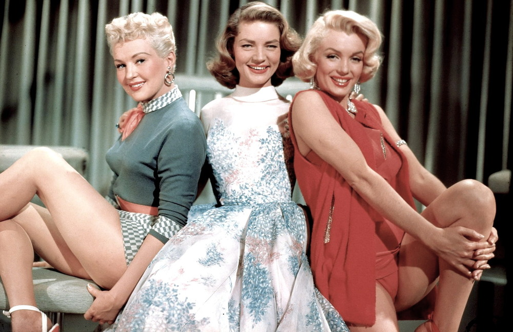 fuckyeahprettyvintage :      classicfilmheroines :     Betty Grable, Lauren Bacall, and Marilyn Monroe in  How To Marry a Millionaire  (1953), a romantic comedy   Costume design by Travilla    Image Source