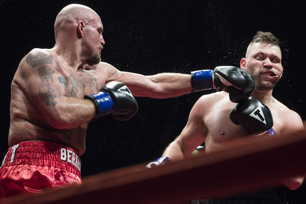 Thad Berkhousen throws a left to the face of Armando Ancona during their Cruiserweight fight at the LC Pavilion in Columbus, Ohio during the Arnold Sports Festival on Saturday, March 7, 2015.