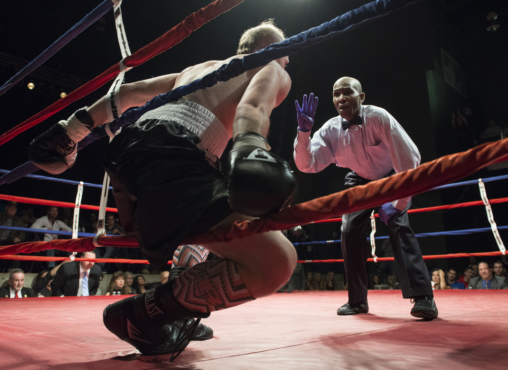 The referee counts over Karl Parks after a blow by his opponent Cory Delaney sent him into the ropes during the Super Middleweight fight at the LC Pavilion in Columbus, during the Arnold Sports Festival on Saturday, March 7, 2015.