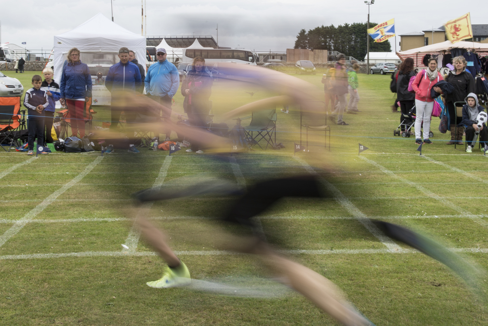 Runners compete in the track and field events at the St. Andrew Highland Games in St. Andrews, Scotland on Sunday, July 26, 2015.