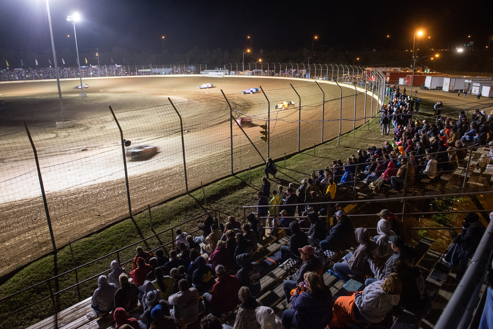 The crowds watch the heat races for the modified cars at the Dirt Track World Championships at Portsmouth Raceway Park.