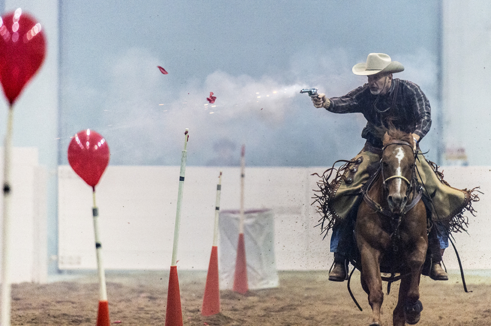 "Eric Schreiber shoots the targets in the ""rundown"" during the 2015 American Quarter Horse Congress shootout in Columbus, Ohio."